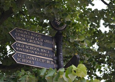Signpost to Simon's Wood, Cemetery & Chapels, Showground, Old School Hall, Winterton Rangers, All Saints Church and Schools